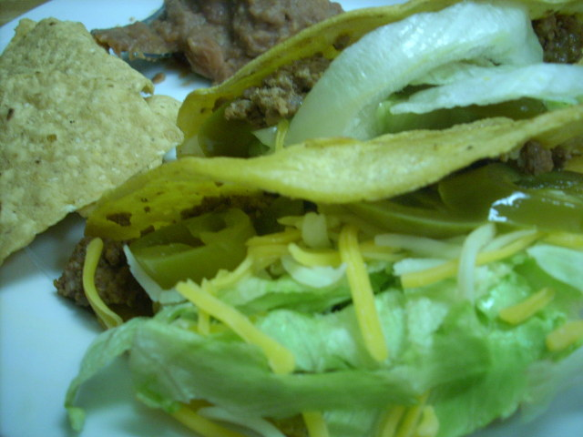 2 tacos (3 oz. beef), 1/2 ounce tortillas and 1/3 cup ff refried beans - and Tabasco and jalapeno slices!